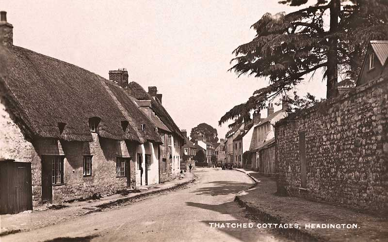 Postcard of the thatched cottages