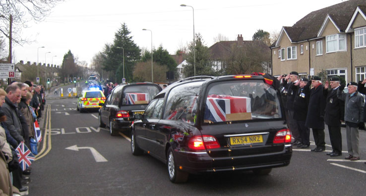 The coffins are draped in union flags
